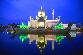 Brunei Bandar Seri Begawan Omar Ali Saifuddien Mosque with stone boat and lagoon by night