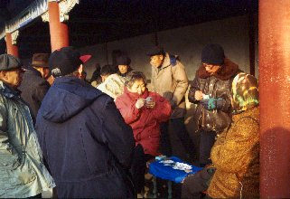 Beijing, card-player in Tiantan Park
