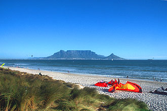 Bloubergstrand beach with Table Mountain and kite surfers