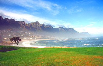 Camps Bay beach with Twelve Apostles mountains in the morning