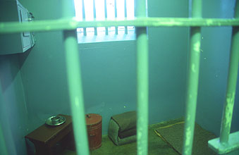 Cape Town Robben Island Nelson Mandelas isolation cell with his artifacts