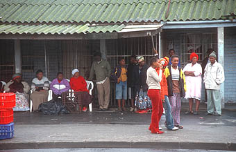 Cape Town Townships people waiting at the bus stop
