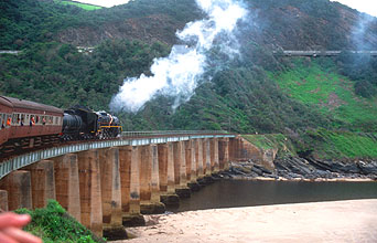 Outeniqua Choo Tjoe steam train crossing a bridge