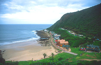 Outeniqua Choo Tjoe steam train houses on the coast