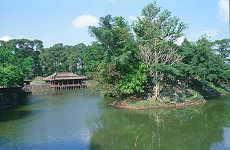 Hue - Royal Tombs lotus pond with building