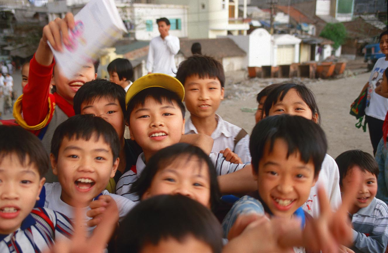 Hanoi vietnamese children grow up in an atmosphere of growth and
