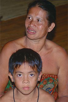 Iban Longhouse mother with son