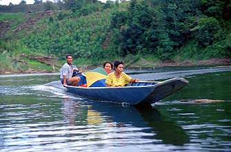 Iban Longhouses: boat crossing on a jungle river