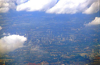 Kuala Lumpur City Centre with Petronas Towers from aircraft