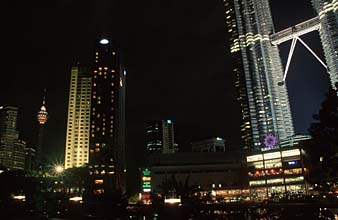 Petronas Twin Towers and KL Tower by night from park