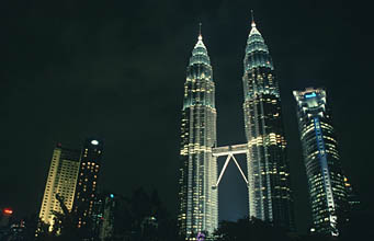 Petronas Twin Towers full panorama by night from park