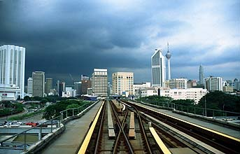 Putra LRT elevated section with dark clouds
