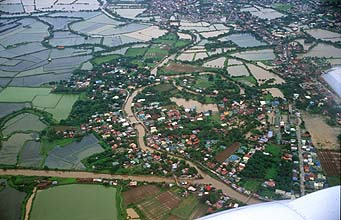 Manila outskirts and ricefields from aircraft