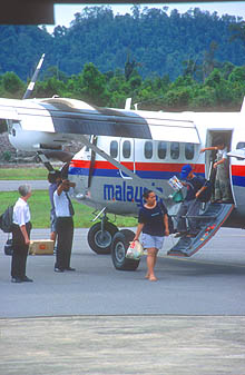 Mulu Airport passengers disembarking from Twin Otter aircraft
