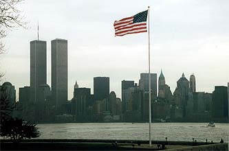 NYC_New_York_Lower_Manhattan_from_Liberty_Island_with_Flag