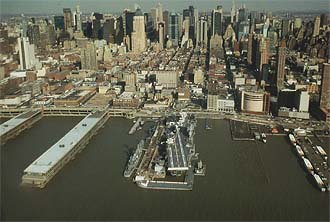 NYC_New_York_Sea_Air_and_Space_Museum_with_Manhattan_from_Helicopter.jpg