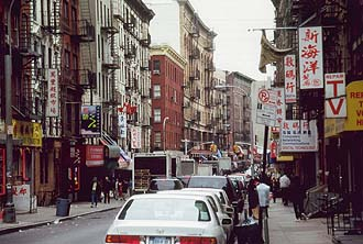 NYC_New_York_Street_in_Chinatown_with_fire_escape_stairs.jpg