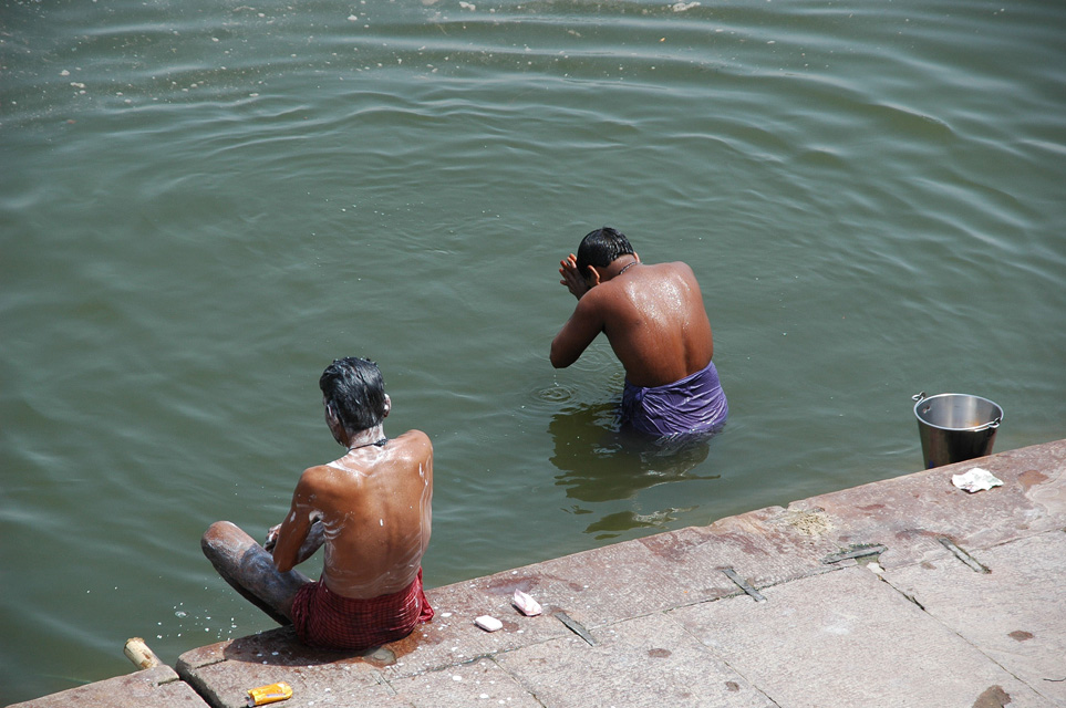 VNS Varanasi or Benares - washing and taking a ritual bath in the holy waters of river Ganges near Harishchandra Ghat 3008x2000