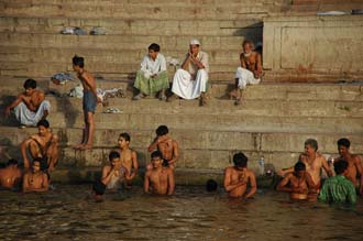 VNS Varanasi or Benares - Hindu men taking a bath in the holy Ganges