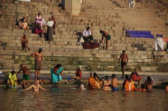 VNS Varanasi or Benares - Hindu pilgrims taking a bath in the holy