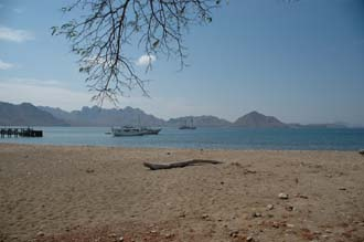 BMU Komodo Island Ombak Putih Komodo National Park UNESCO world heritage site beach panorama with pier 3008x2000