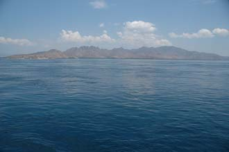 BMU Komodo Island Ombak Putih sailing ship Komodo island panorama with apparently calm waters fraught with whirlpools 3008x2000