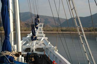 BMU Komodo Island Ombak Putih sailing ship view from upper deck to the island with bow after sunrise 3008x2000
