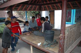 AMI Lombok Karangbayan traditional Sasak village playing chess in bale 3008x2000