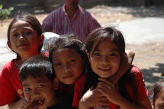 AMI Lombok Masbagik Timur pottery village happy smiling kids with red T-shirts 4 3008x2000