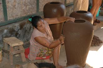 AMI Lombok Masbagik Timur pottery village woman applying ornaments on the potteryware before burning 3 3008x2000