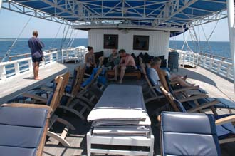 AMI Lombok Ombak Putih sailing ship Gili Nanggu Island upper deck with deck chairs 2 3008x2000