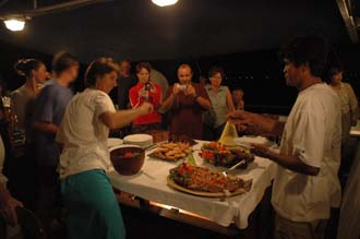 AMI Lombok Ombak Putih sailing ship open air buffet for dinner on lower deck 1 3008x2000