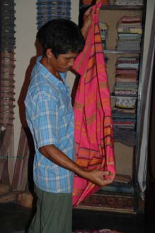 AMI Lombok Pringgasela traditional weaving village colourful clothes in a shop 2 3008x2000