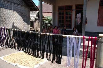 AMI Lombok Pringgasela traditional weaving village dyed threads drying in the sun 3008x2000