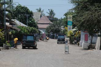 AMI Lombok Pringgasela traditional weaving village main street with donation box 3008x2000