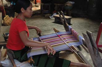 AMI Lombok Pringgasela traditional weaving village woman weaving on simple loom 1 3008x2000