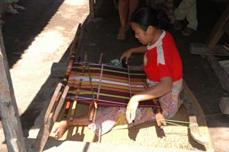 AMI Lombok Pringgasela traditional weaving village woman weaving on simple loom 2 3008x2000