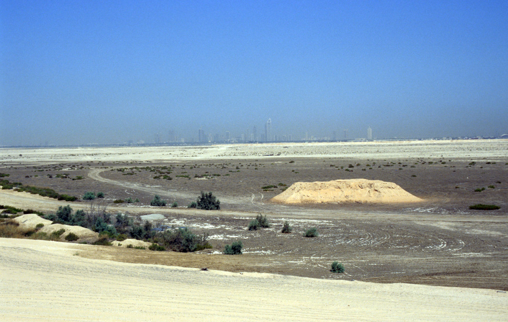 DXB Dubai - the skyline of Jumeirah with desert seen from the highway leaving Dubai in south-eastward direction towards Hatta Oasis 01 5340x3400